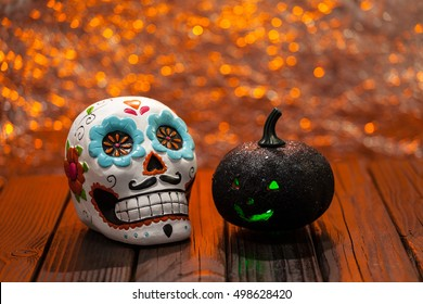 Halloween Celebration Dia De Los Muertos Background With Sugar Skull And Black Pumpkin. Selective Focus With Copy Space.