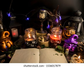 Halloween celebration, Samhain, magic ritual, burning candles and natural stones, witchcraft, Wicca, skull