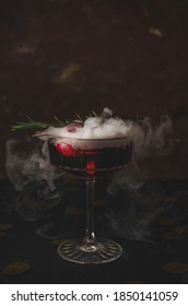Halloween cocktail with eye and fog
