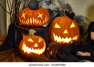 Halloween composition of a burning pumpkin with a bat. High quality photo
