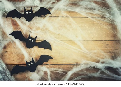 Halloween concept with bats on wooden table