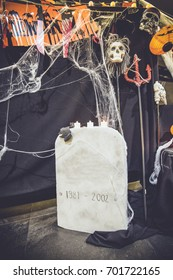 Halloween concept decorate. Trick or treat. Bat souls of the dead and the white candle. Put on tombstone covered with cobweb. Skull Head and halloween pumpkin head background.