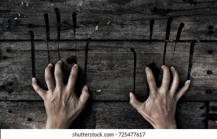 Halloween concept, Horror women hand scratch on wood wall with dark tone.
