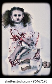 Halloween Concept Image of Ghost Girl in Blood with Doll
