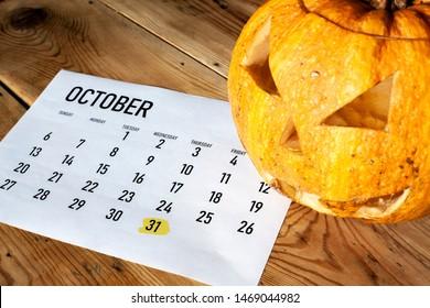 Halloween concept. October calendar with - October 31 Halloween day marked and Pumpkin - Jack-o'-lantern