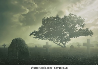 Halloween Concept, Spooky graveyard scene complete with scary trees, deep fog and Creepy clouds.