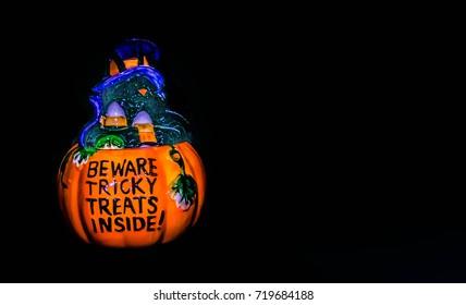 Halloween cookie jar on a black background