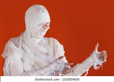 Halloween, costume image. The mummy in bandages making gestures. Super like, thumbs up gesture