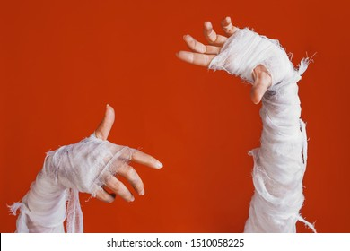 Halloween, costume image. The mummy's hand in bandages making gestures, mummy makes a frame for your label, copy space