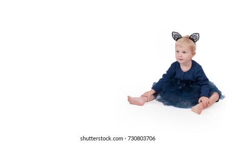 Halloween costume. Little toddler girl dressed for Halloween as black cat