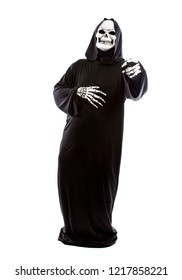 Halloween costume of a skeleton grim reaper wearing a black robe on a white background laughing