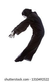 Halloween costume of a skeleton grim reaper wearing a black robe on a white background acting like getting hit or beat up by someone