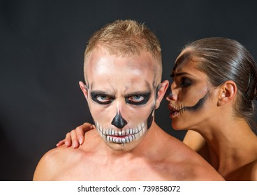 Halloween Couple in love with naked body. woman and man has scary face embrace. Zombie party and horror. Halloween Holiday and celebration. couple with makeup on face on black background.