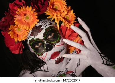 Halloween, Day of the Dead body paint woman in ghost katrina with flowers decoration on head