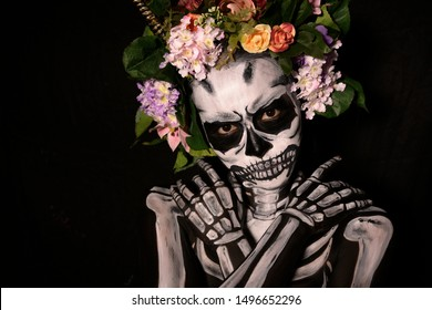 Halloween, Day of the Dead portrait body paint decorated with flowers, Horror concept.