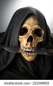 Halloween Death Skeleton head hold knife in mouth