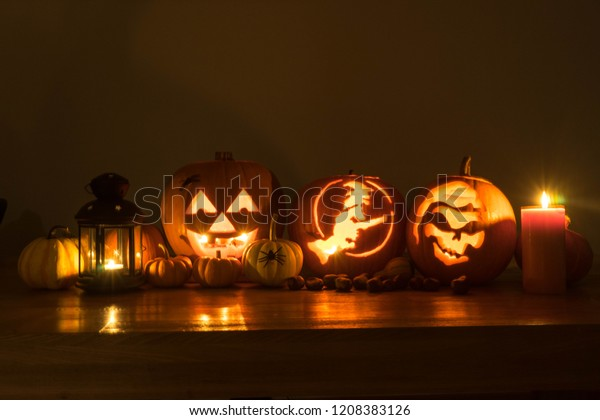 Halloween decorated pumpkins with candles and lamp
