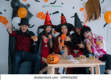 halloween and decoration concept-teen have fun together in Halloween festival, friends in Halloween party,Group of creepy Friends singing together at the party