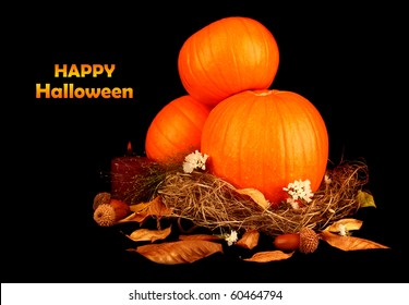 Halloween decoration with pumpkins isolated on black