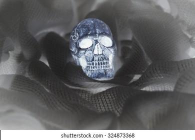Halloween decoration with skull on bandage, negative film effect