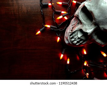 Halloween decoration/lights on a dark wooden background with copy space