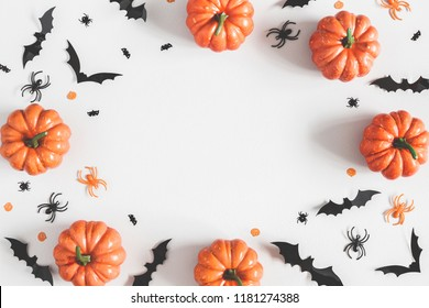 Halloween decorations on pastel gray background. Halloween concept. Flat lay, top view, copy space