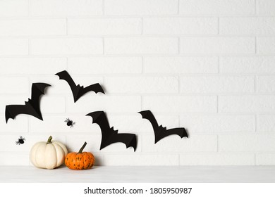 Halloween decorations on white brick wall background