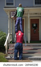 Halloween display of Shaquille O'Neal standing on shoulders of Lebron James in Boston, MA