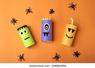 Halloween DIY and kids creativity. Eco-friendly reuse recycle from toilet roll tube. Children Paper Craft monster, pumpkin, frankenstein. Development imagination and sensory motor skills