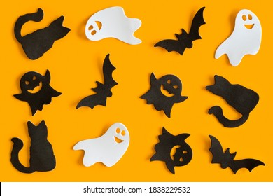 Halloween. Halloween figurines pattern on orange background. Halloween symbols.  Halloween concept.