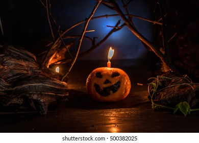 Halloween fruit on dirty background