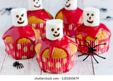 Halloween ghost cupcakes with blackberry glaze and marshmallow