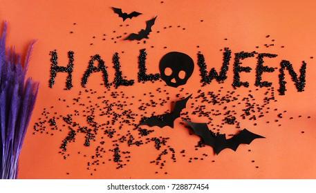 Halloween glitter on orange background