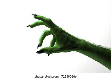 Halloween green witches or zombie monster hand