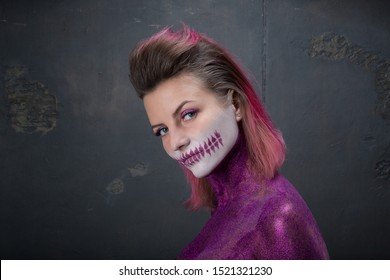 Halloween hairstyle. pink art makeup with sparkles sugar skull, model shooting. visage skill. Hairstyle and makeup with colored sparkles. Beauty saloon. Makeup Artist Contest. pink hair