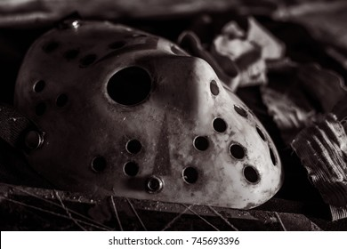 The Halloween Hockey mask like Jason Voorhees. Putting on table setting for do something with bandage and old rusty blade. B/W - Close up