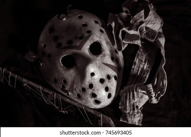 The Halloween Hockey mask like Jason Voorhees. Putting on table setting for do something with bandage and old rusty blade. B/W