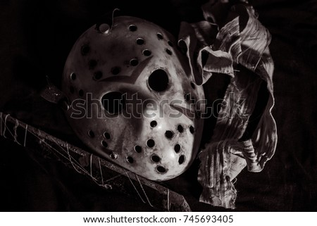 the halloween hockey mask like jason voorhees putting on table setting for do something with