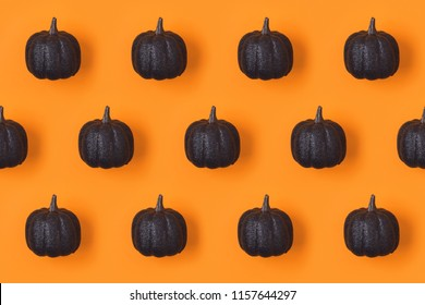 Halloween holiday background with glitter  pumpkin decor. View from above. Flat lay