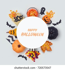 Halloween holiday banner design with candy corn and party decorations. View from above. Flat lay