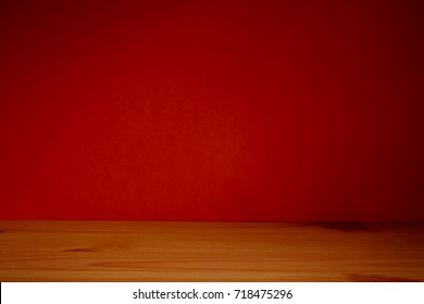 Halloween holiday concept. Empty rustic table in front of orange wooden background