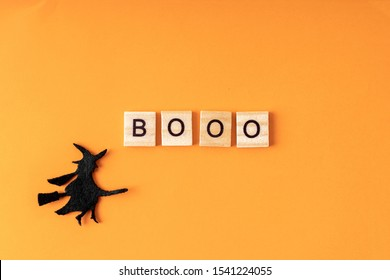 Halloween holiday minimal top view image of letter with text and whitch. Holiday background