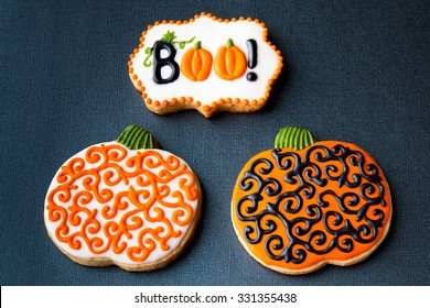 Halloween homemade cookies on black background with copy space.