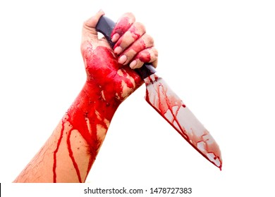 Halloween horror concept Picture of a demon hand And the murderer holds a knife full of blood, isolated on a white background assassin