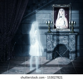 Halloween horror concept. Sad white transparent woman ghost looking on her portrait on a wall in old castle