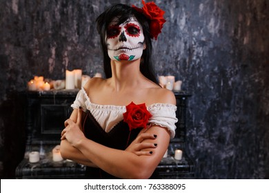 Halloween image of woman with makeup and roses