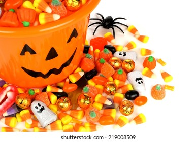 Halloween Jack o Lantern pail overhead view with pile of candy