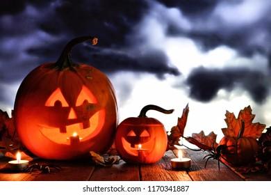 Halloween Jack o Lanterns. Night scene with a dark cloud background.