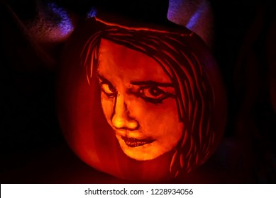 Halloween jack-o-lantern pumpkin carved to look like a girl's face (carved by the photographer)