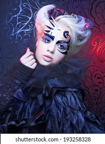 Halloween lady in black. Young woman in creative magic image.